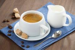 Cup of espresso, sugar and jug of milk Stock Image