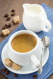 Cup of espresso, sugar and jug of milk, top view Royalty Free Stock Photography