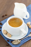Cup of espresso, sugar and jug of milk, vertical Royalty Free Stock Images