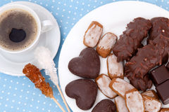 Cup of espresso and sweets. On blue tablecloth Royalty Free Stock Photography