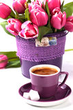 Cup of espresso with tulips Royalty Free Stock Photos