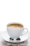 Cup of espresso on a white table and space for text, vertical Royalty Free Stock Photo
