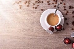 Cup of espresso on wood table with shine top view Royalty Free Stock Photos