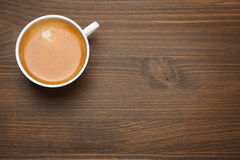 Cup of espresso on a wooden background, concept photo Stock Images
