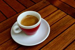 Cup of espresso on a wooden table. A cup of espresso shot on a wooden table Stock Photo