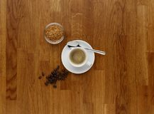 A cup of espresso on a wooden work top, shot from above. stock photography