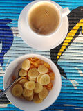 Cup of esspresso and cereal with banana, breakfast set Royalty Free Stock Images