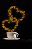 Cup with fantasy golden double heart shape steam Royalty Free Stock Photo