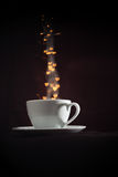 Cup with fantasy golden heart shape steam Stock Image