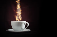Cup with fantasy golden heart shape steam Stock Images