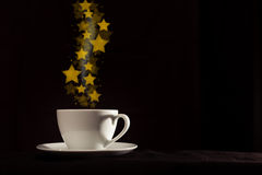 Cup with fantasy golden star shape steam Royalty Free Stock Images