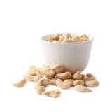 Cup filled with the cashew nuts isolated Stock Photography