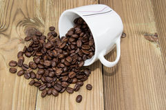 Cup filled with Coffee Beans Stock Photos