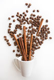 Cup filled coffee beans with chocolate and orange. On white background Royalty Free Stock Photo
