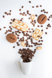 Cup filled coffee beans with chocolate tiramisu. Cup filled coffee beans with chocolate and tiramisu on white Stock Photography