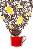 Cup filled coffee beans with orange on white Stock Photo