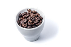 Cup filled with coffee grains Royalty Free Stock Images