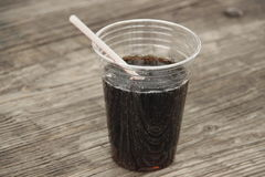 Cup filled with cola soda, out doors Stock Photos