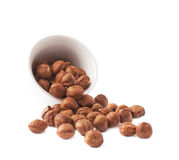 Cup filled with the hazelnuts isolated Royalty Free Stock Photography