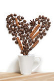 Cup filled  heart coffee  with cinnamon  on white. Cup filled  heart silhouette coffee  with cinnamon  on white background Stock Image