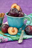 A cup filled with plums Royalty Free Stock Photos