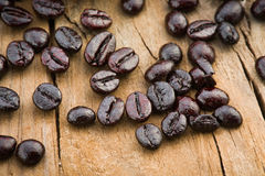 Cup filled with roasted coffee beans Royalty Free Stock Photos