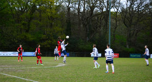 Cup Final Match. Shamen Blythe playing for AFC Haywards mens team, can be seen heading the ball in the AFC Haywards Vs Cuckfield cup final football match, ` Royalty Free Stock Photo