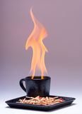Cup of fire Stock Image