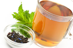 Cup of flavored black tea Stock Images