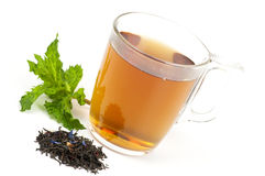 Cup of flavored black tea Stock Photos