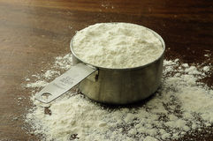 A cup of flour royalty free stock photography