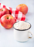 Cup of flour, butter, red apples and sugar Stock Images