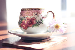 Cup with flower and sauser Stock Images