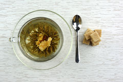 Cup of flowering tea with sugar Stock Photography