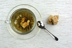 Cup of flowering tea with sugar Royalty Free Stock Image
