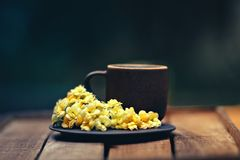 Cup and Flowers on Saucer Plate stock image