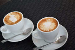 Cup Of Foamy Cappuccino On The Black Background Royalty Free Stock Image