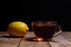 Cup of fragrant black tea Stock Photos
