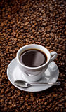 Cup with fragrant coffee drink on beans background Stock Image