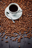 Cup with fragrant coffee drink on beans background Royalty Free Stock Photo