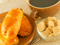 Cup of fragrant coffee and fresh pies Stock Photography