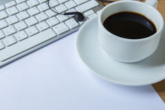 Cup of fragrant coffee and keyboard Royalty Free Stock Photo