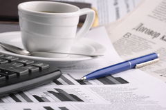 Cup of fragrant coffee on a morning paper business. News Royalty Free Stock Images