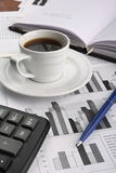 Cup of fragrant coffee on a morning paper business. News Stock Images