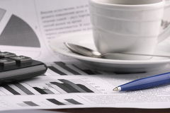 Cup of fragrant coffee on a morning paper business Stock Images