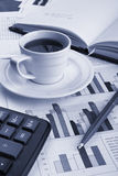 Cup of fragrant coffee on a morning paper business. News Stock Photo