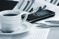 Cup of fragrant coffee on a morning paper business. News Stock Image