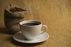 Cup of fragrant, hot coffee Stock Image