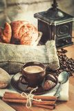Cup fragrant hot coffee with bean chocolate. Sweet and croissant in vintage rustic style cinnamon steam smoke on wooden board for bracing morning breakfast Royalty Free Stock Photo