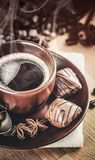 Cup fragrant hot coffee with bean chocolate Stock Images